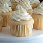 White Cupcakes with Truffle Filling and White Chocolate Cream Cheese Frosting