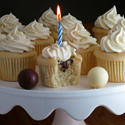 truffle filled white cupcakes with white chocolate cream cheese icing