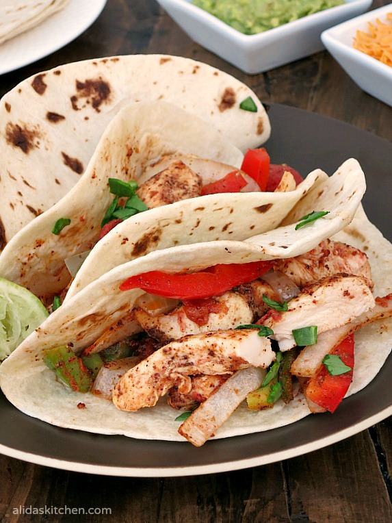 An easy recipe for Baked Chicken Fajitas | alidaskitchen.com